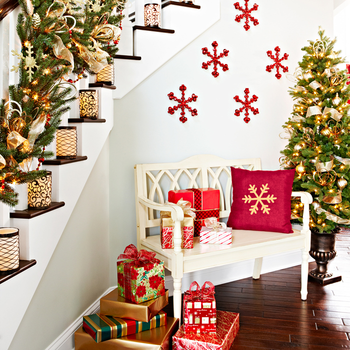 Bold-snowflakes-in-red-on-the-wall-add-to-the-staircase-decorations