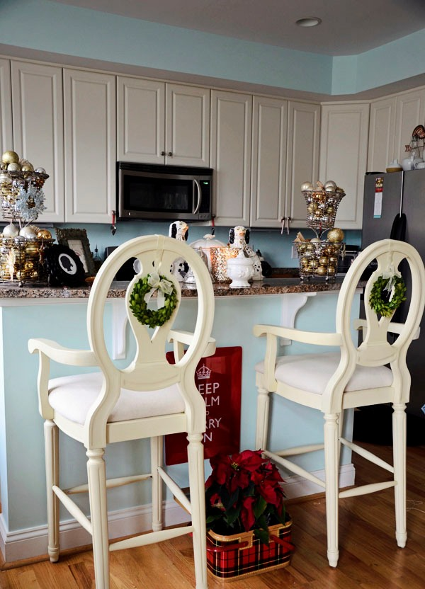 Bar stools with boxwood wreaths