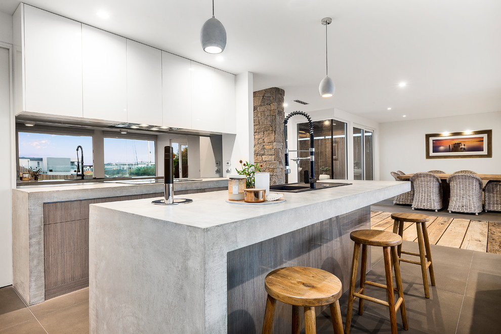 Timber Veneer Kitchen With Polished Concrete Tops