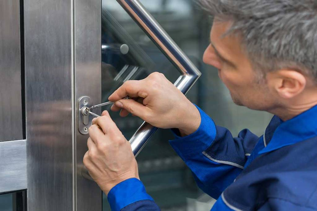 Male Lockpicker Fixing Door Handle At Home