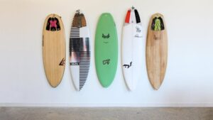 How to Store Your Surfboards in Your in Your Home + Caring Tips