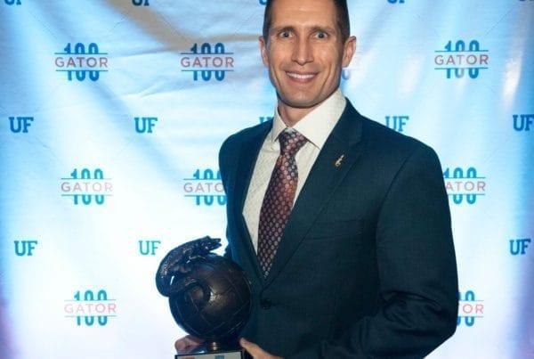 Jay Conroy with Gator 100 award