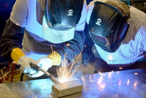 two males welding