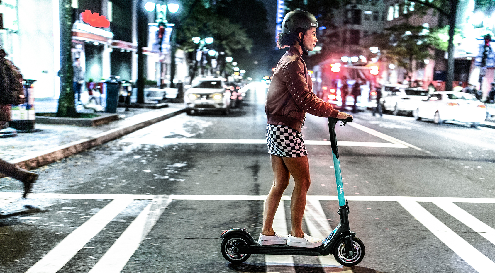 Young woman riding scooter