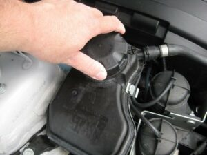 Coolant Drained Into A Recovery Bottle/Tank