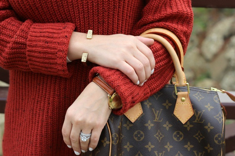 Gold bangle, white nails, and Michael Kors watch