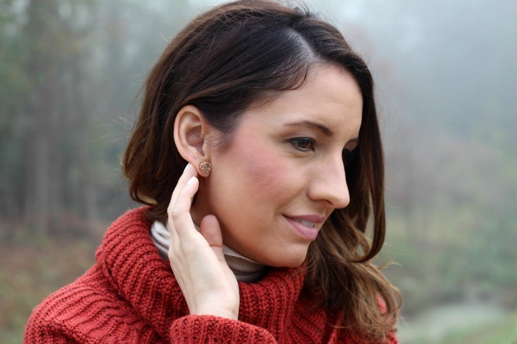 Kendra Scott earrings, and a cowl neck sweater