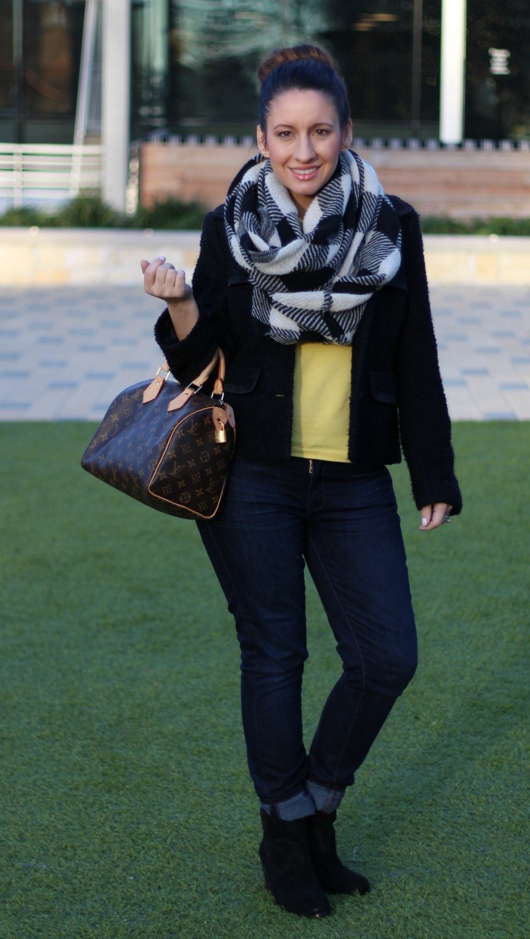 Infinity scarfs, black coat, yellow polo, skinnies, and booties