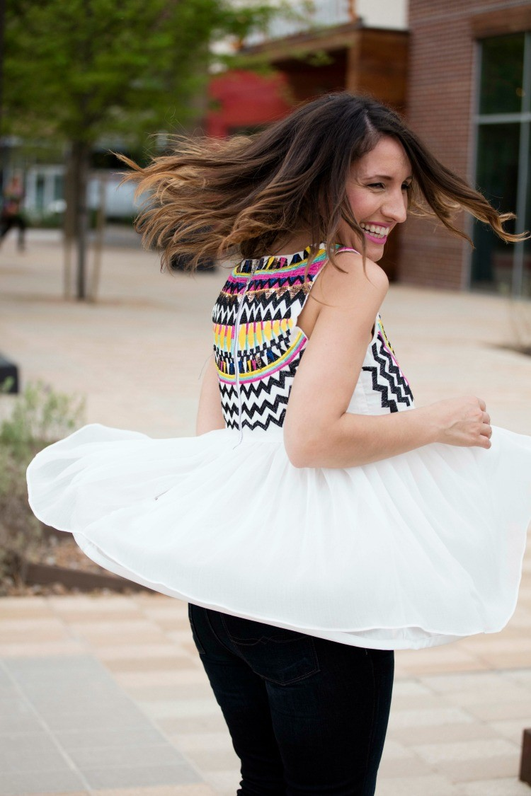 Twirling in the prettiest White Sleeveless Embroidery Pleated Chiffon top