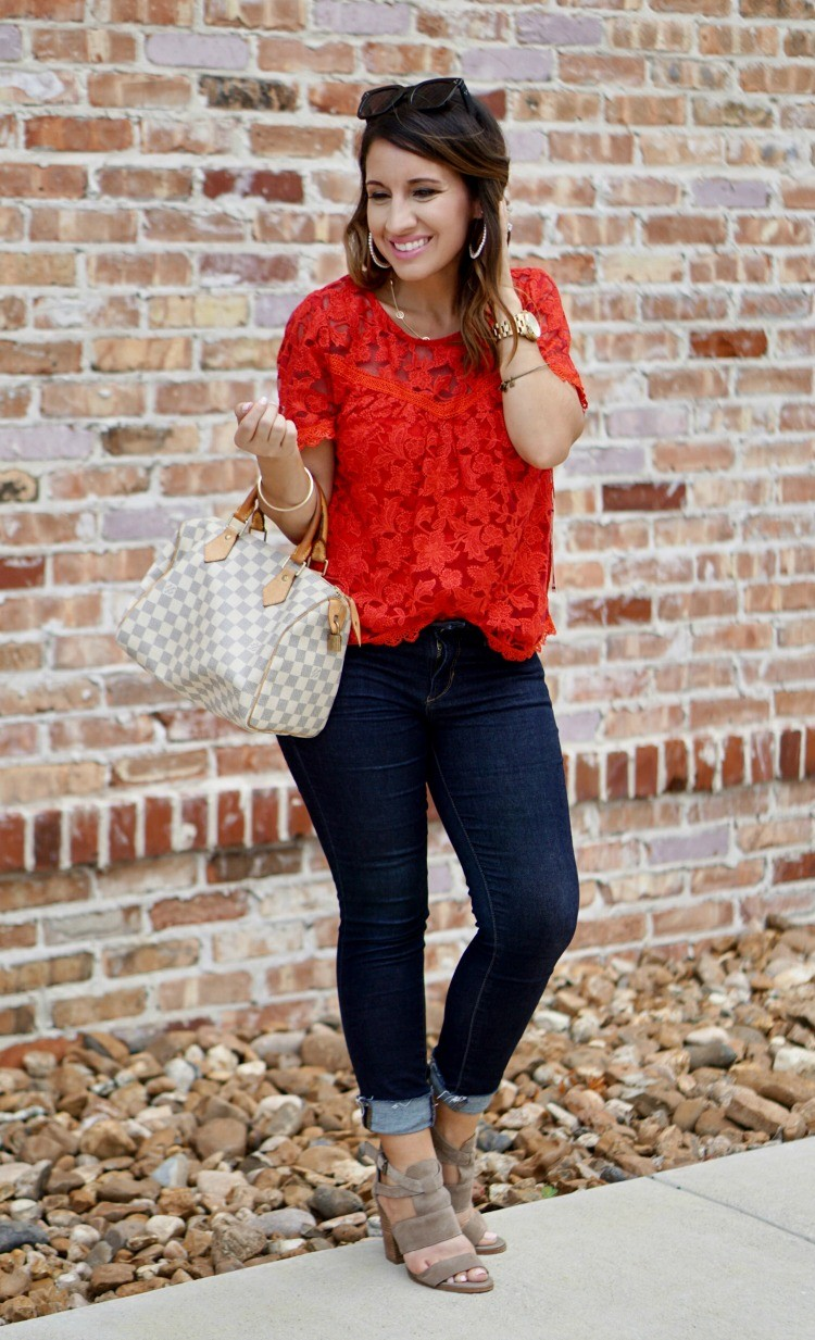 Red lace top, skinny jeans, and louis vuitton bag
