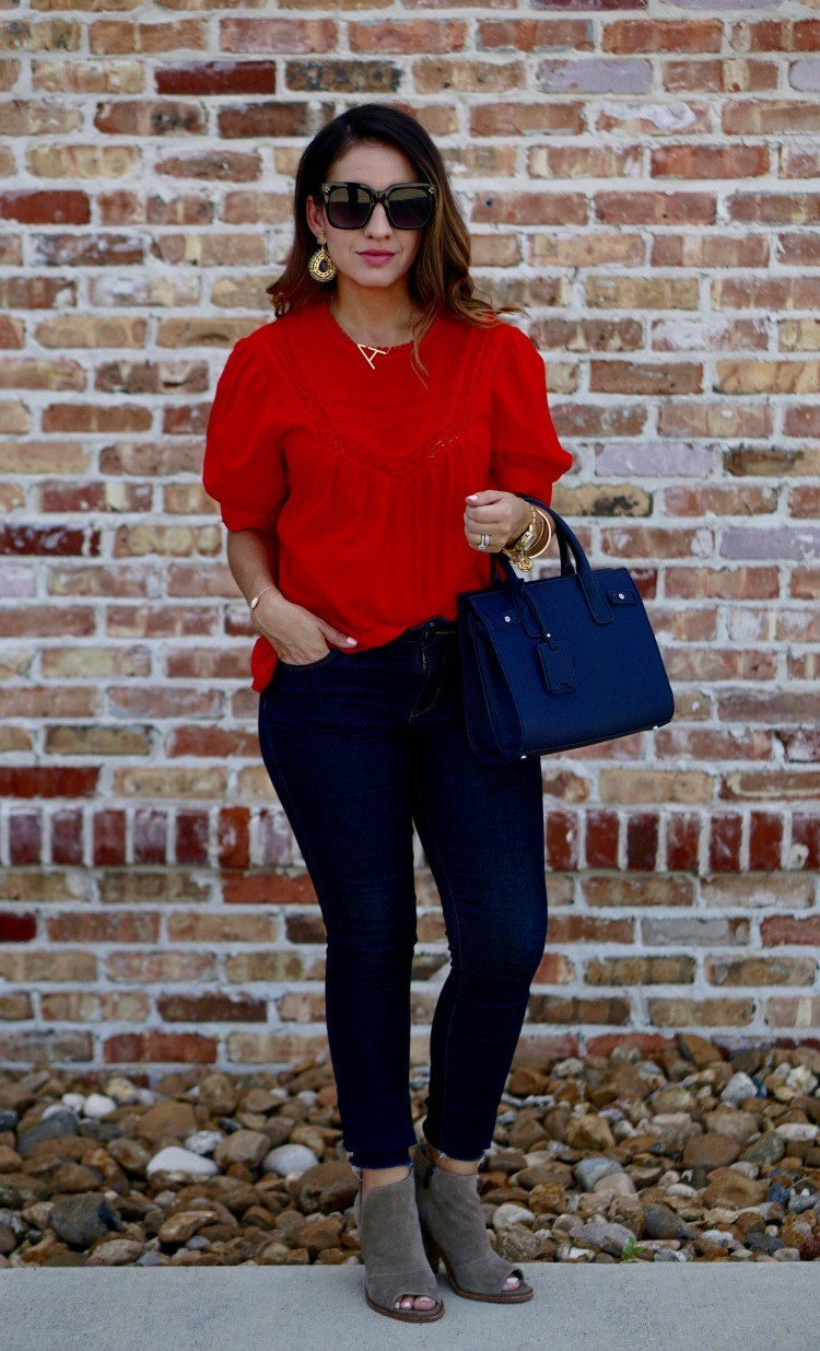 Red lace trim top, dark skinny jeans and booties