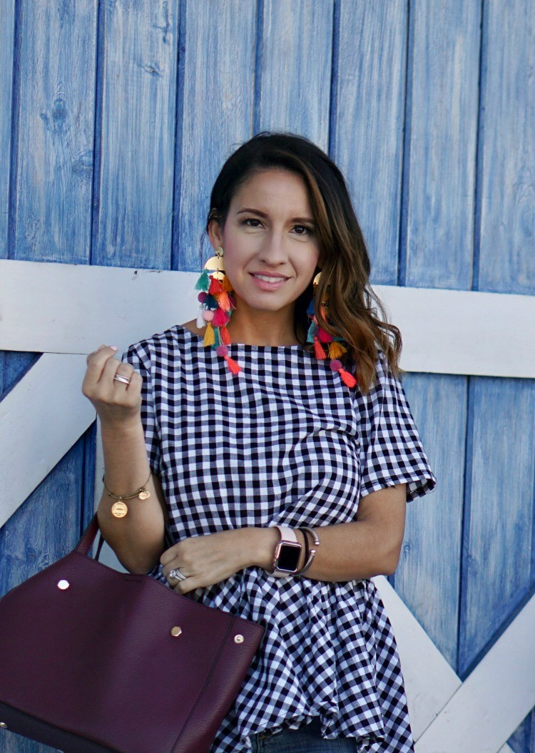 Statement earrings and gingham top