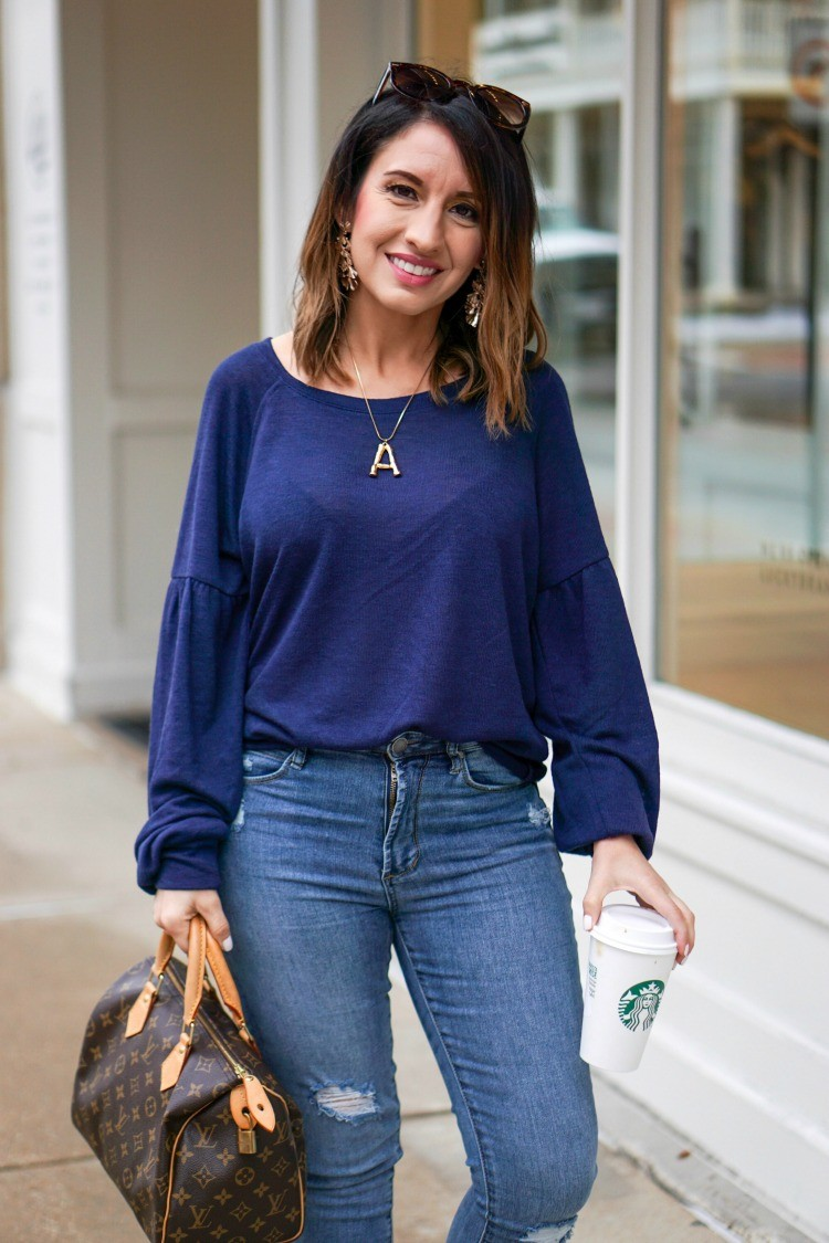 Blue sweater, blue jeans, and sunglasses