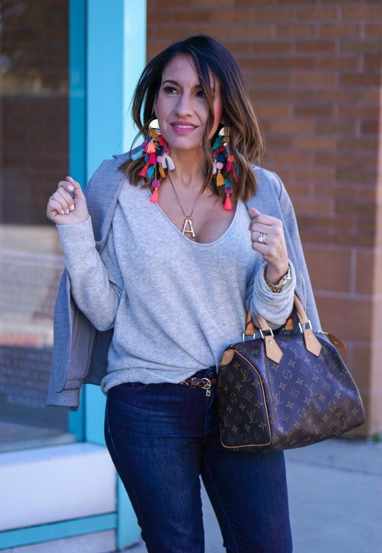 Dark grey blazer, grey knit top, dark skinny jeans, and brown Louis Vuitton Bag