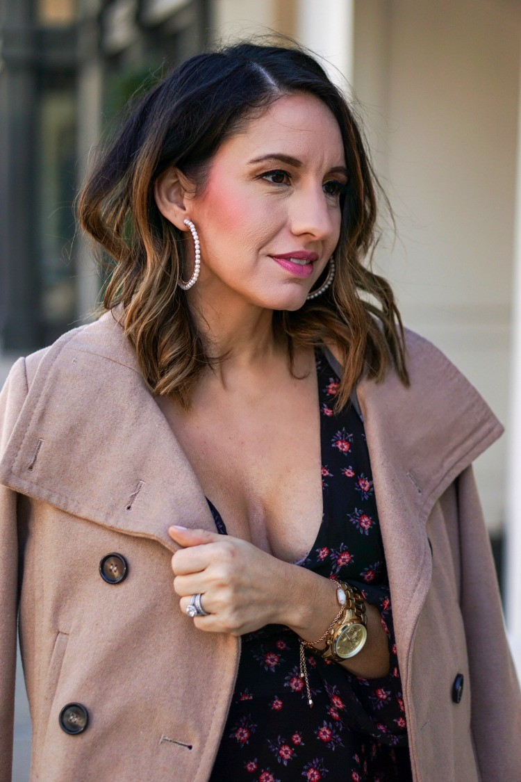 Pearl hoops, camel coat, and black floral dress