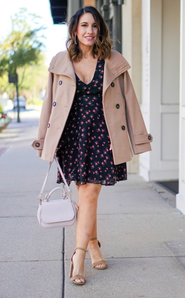 Pearl statement earrings, camel coat, floral dress, nude heels, and pink handbag