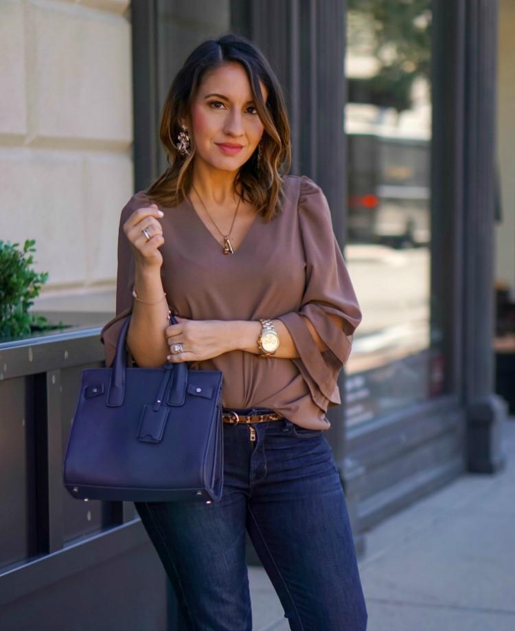Sassy blouse, leopard belt, and dark skinny jeans