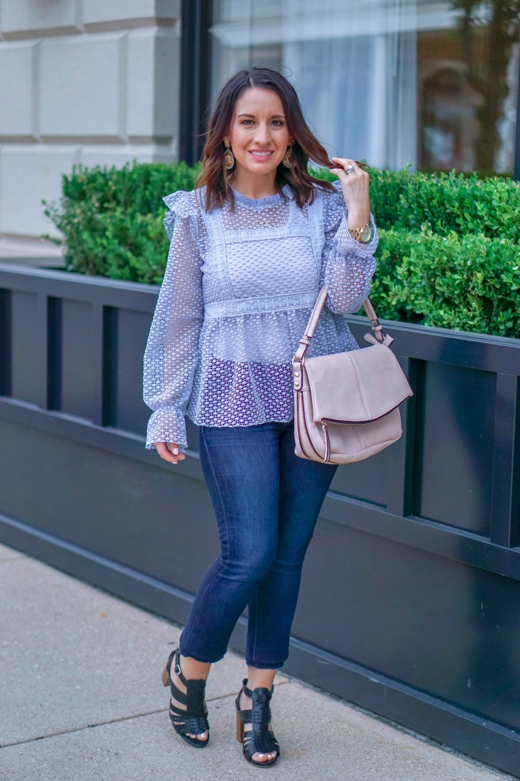 statement earrings, blouse. skinny jeans, and heels