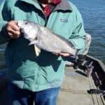 Paul fishing at Lake close to Village