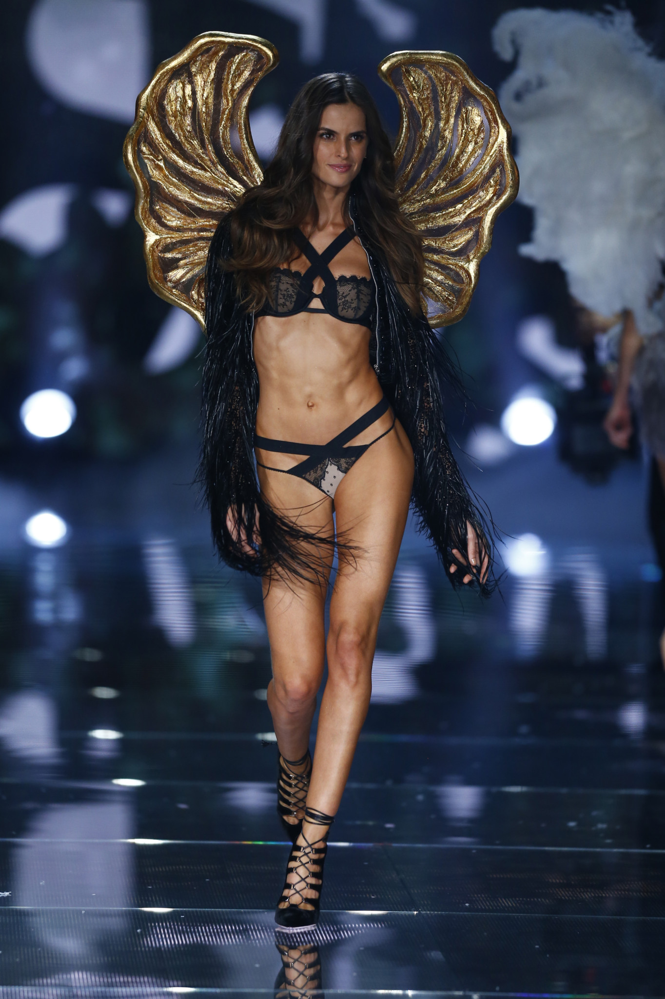 NEW YORK, NY - NOVEMBER 10: Model Izabel Goulart walks the runway during the 2015 Victoria's Secret Fashion Show at Lexington Avenue Armory on November 10, 2015 in New York City.