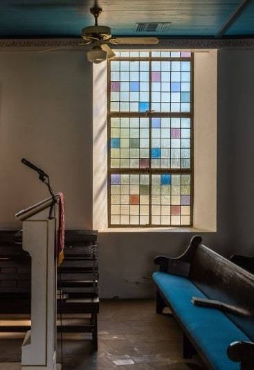 Vertical window with colorful class in church