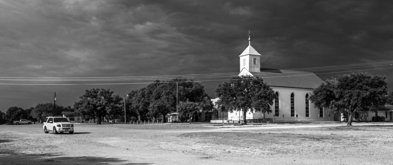 Black and white side shot of old church in Texas