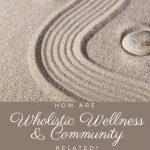 An image of stones in the sand - How Are Wholistic Wellness and Community Related