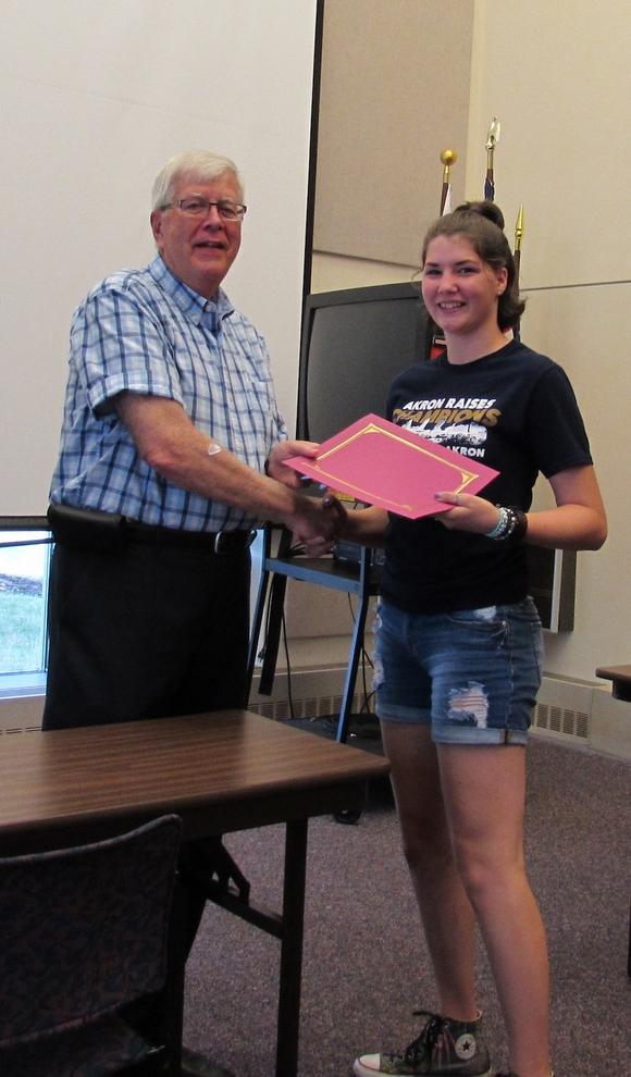Mayor James Costello hands Melody Brajera a certificate commemorating her participation with the summer job program.