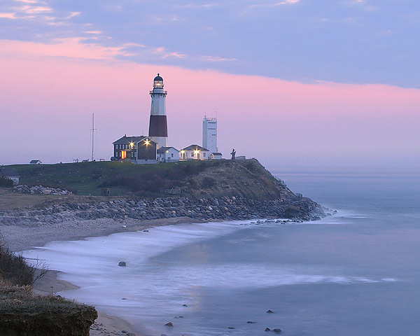 Shore line with lighthouse in distance, sunset