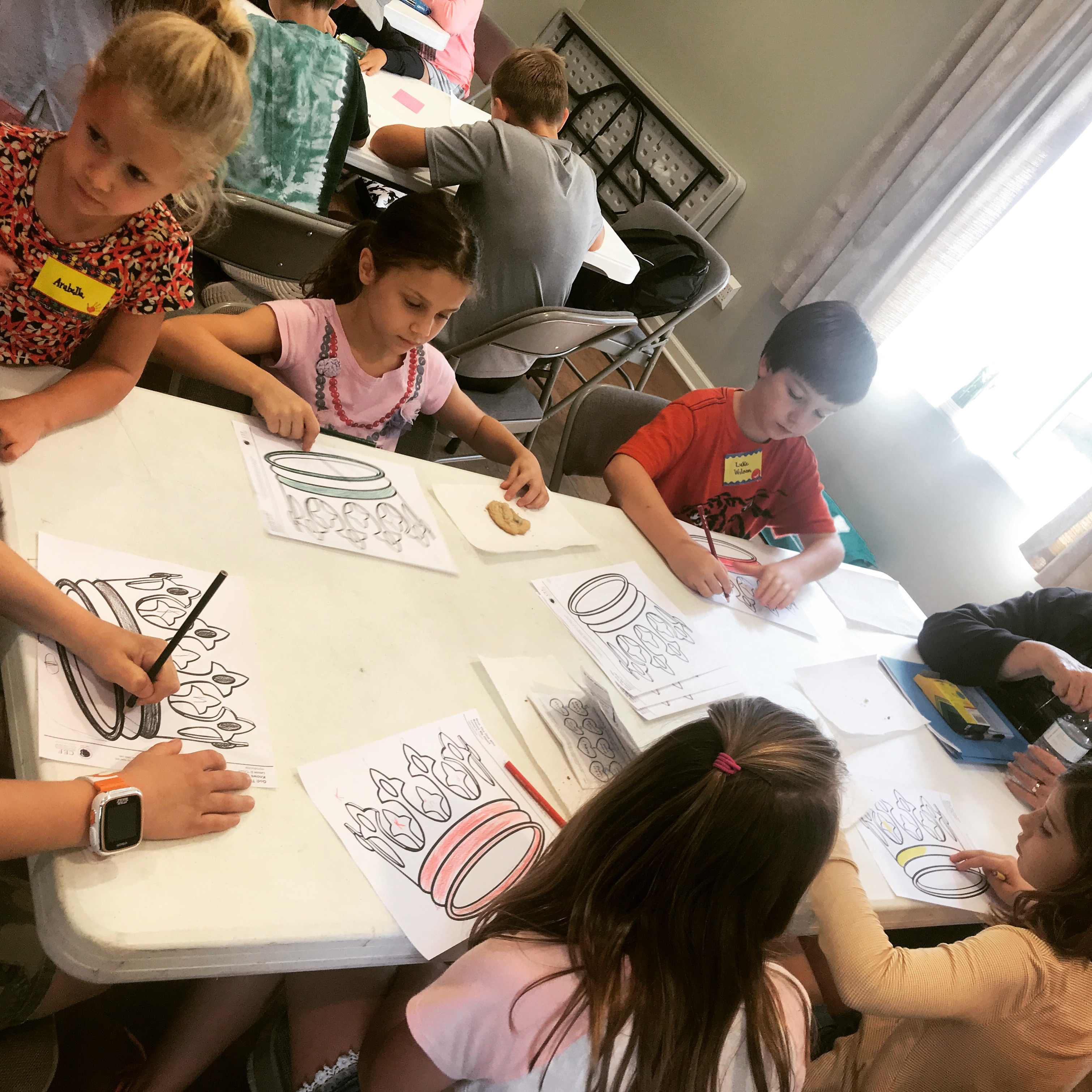 Bible students work on a worksheet during discussion time at Learn Together Lowcountry homeschool co-op in Bluffton SC