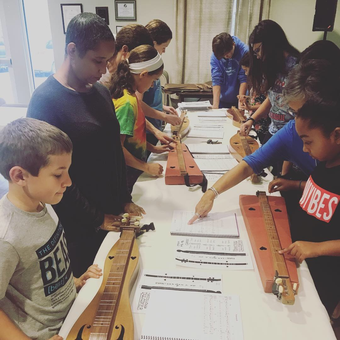 Students learn how to play the mountain dulcimer at a weekly wow workshop at Learn Together Lowcountry homeschool co-op in Bluffton SC