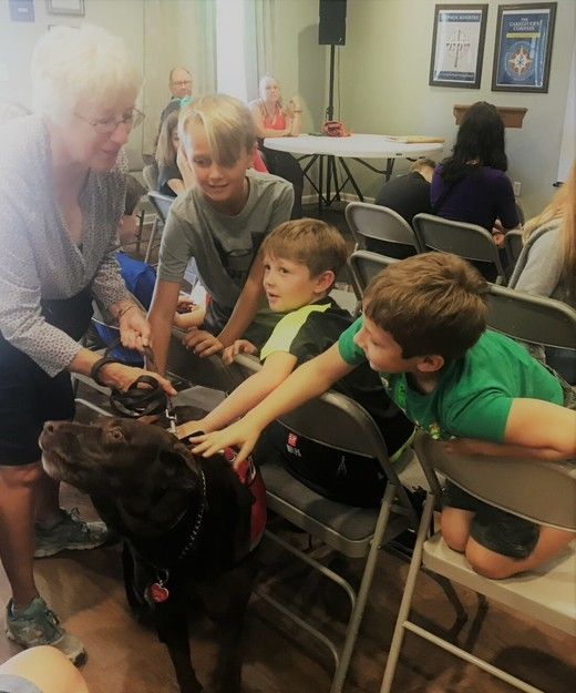 Students greet the therapy dog at a weekly wow workshop at Learn Together Lowcountry homeschool co-op in Bluffton SC