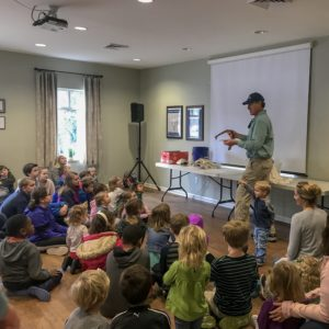 Tony Mills shows a large group of students a snake at a weekly wow workshop at Learn Together Lowcountry homeschool co-op in Bluffton SC
