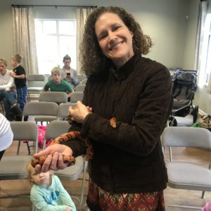 A teacher holds a snake at a weekly wow workshop at Learn Together Lowcountry homeschool co-op in Bluffton SC