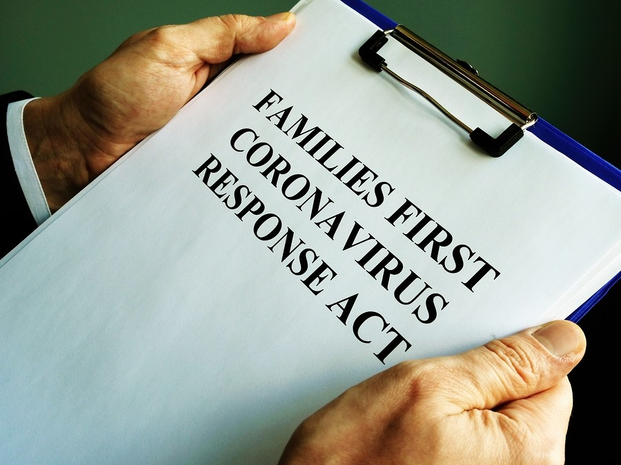 image showing Businessman Reads Families First Coronavirus Response Act Ffcra.