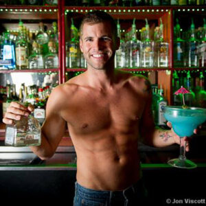 Fiesta Cantina bartender with Patron Silver tequila and a Cancun Mega Margarita