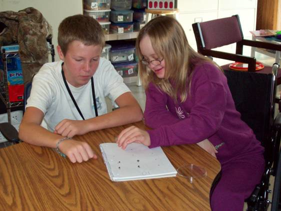 Greenhouse students working together on worksheet