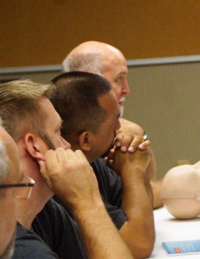 Image of CPR students paying close attention to training