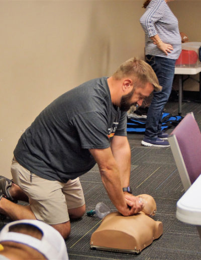 Photo of a student practicing chest compressions