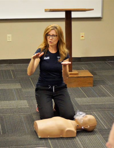 Photo of Instructor explaining CPR to students