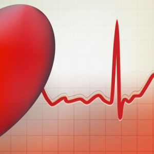 Image of heart superimposed on electrocardiogram graph