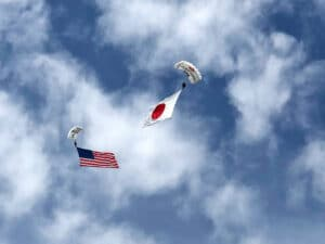 Skydive members perform with American Flag and Japanese Flag.