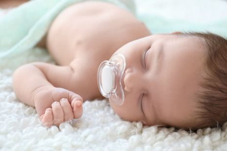 Baby teething with pacifier