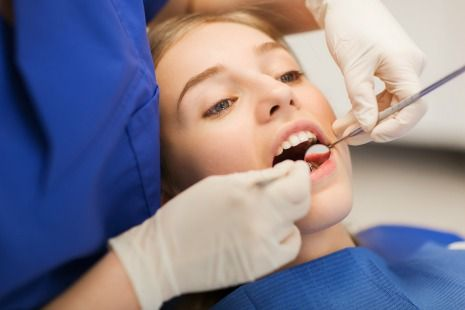 Having your teeth professionally cleaned every six months to help prevent decay