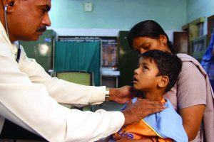 A doctor checks a child for symptoms of TB © Gary Hampton
