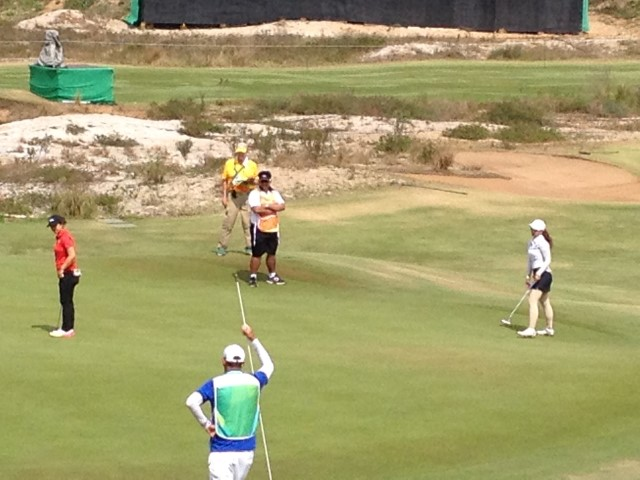 Duane (in Yellow) Scoring the Women's Competition on #18 green: Sei Young Kim, Korea (in Red), Pomanong Phatlum, Thailand (in White).
