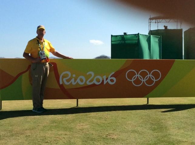 Duane in his Yellow Walking Scorer Olympic Uniform