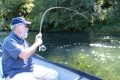 Vietnam veteran Leon hooks into a big one on one of Rivers of Recovery's fly-fishing programs.
