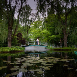 Bridge over a pond of water lilies by Monet. NJ Engagements & Weddings