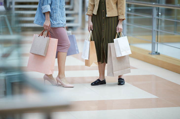 Two ladies holding shopping bags